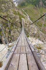 Trift Bridge is the longest pedestrian-only suspension bridge in the Alps, 170 m in length and traversing a height of 100 m. The bridge spans the lake, Triftsee, near Gadmen, Switzerland