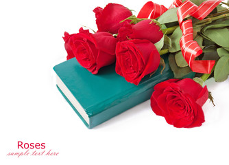 Book and red velvet rose bunch isolated on white. Teacher's day concept