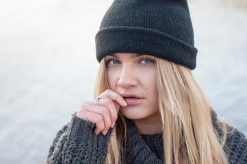 portrait of a beautiful girl in winter hat