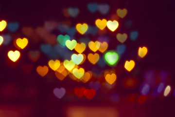 Bokeh hearts background, natural lens bokeh of night city lights.