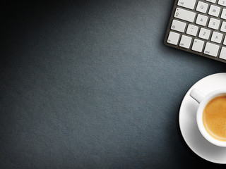 Coffee mug on the table with a keyboard