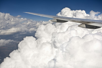 Cloud formation and airplane wing at altitude