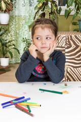 Dreamy child draws