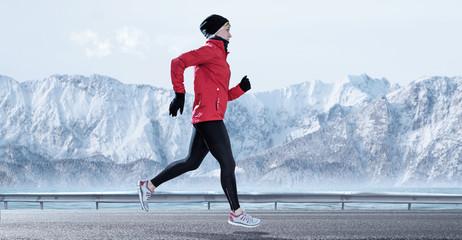 female Runner in winter mountain surrounding
