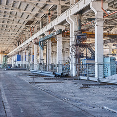 Long industrial warehouse of pipe plant