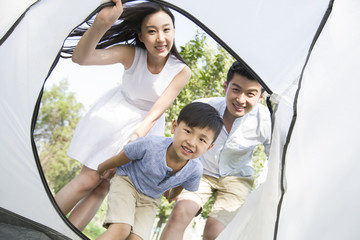 Happy young family enjoying a camping trip