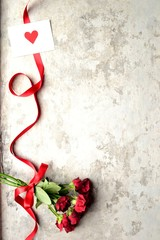 Red rose bouquet with red heart message card