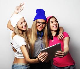 Three girls friends taking selfie with digital tablet