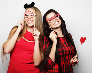 girls best friends wearing red dress  ready for party