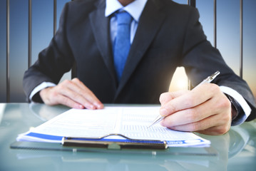 Businessman Signing Application Form Suit Concept