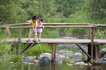 Portrait of two children fishing