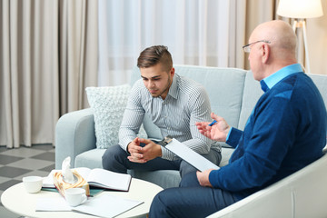 Young man on reception at psychologist