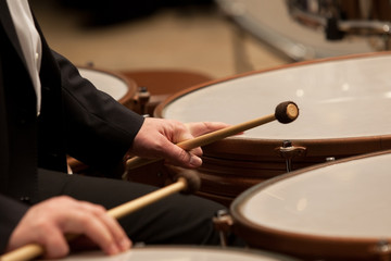 Hands musician playing timpani