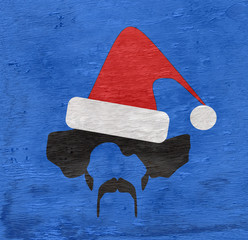 man with afro and santa hat on wood grain texture