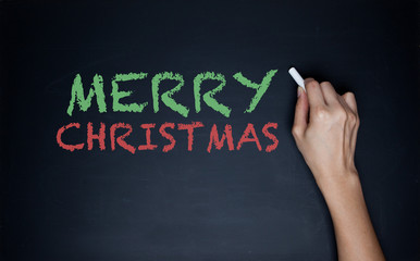 Blackboard With English Text Merry Christmas As Greeting Card.
