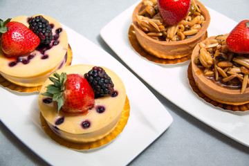 almond nut tart on top fresh strawberry and blueberry cheese