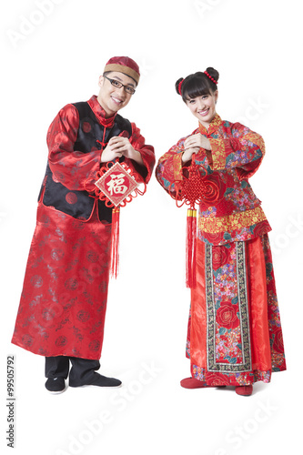 Young couple in traditional chinese clothing greeting for chinese young couple in traditional chinese clothing greeting for chinese new year m4hsunfo