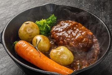 スキレットと焼きたてハンバーグステーキ  American dish hamburger steak