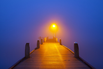 Jetty on a foggy morning at dawn
