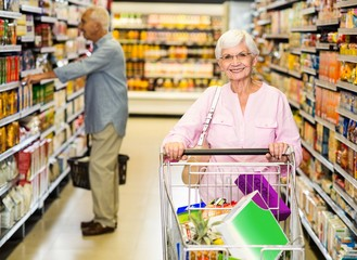 Senior woman pushing trolley