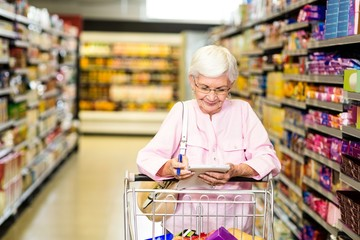 Senior woman looking at her grocery list