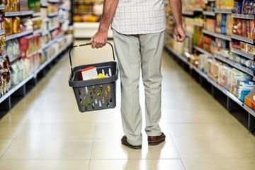 Rear view of senior man holding basket