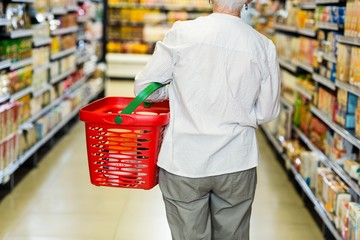 Rear view of senior woman with basket