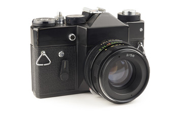 Old vintage camera isolated on white background