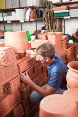 Man choosing flower pot