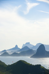 City skyline scenic overlook of Rio de Janeiro, Brazil with Niteroi, Guanabara Bay, and Sugarloaf Mountain