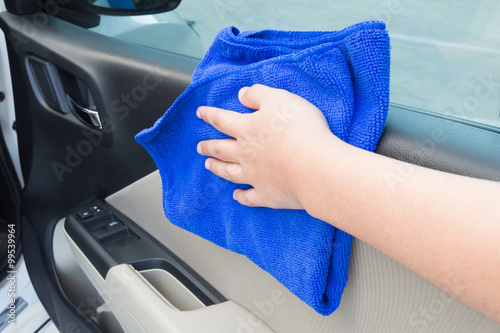 Woman Hand Cleaning Interior Car Door Panel With Microfiber Clot
