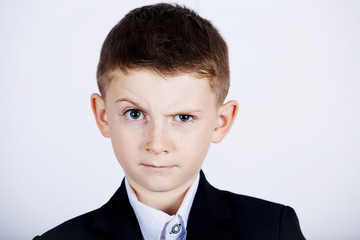 Funny emotion of  little boy young man with a raised eyebrow wearing costume with braces.Happy little boy over white background.Smiling, Happy, Joyful beautiful little boy , looking at camera.