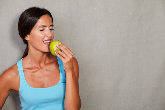 Caucasian ethnicity woman eating an apple