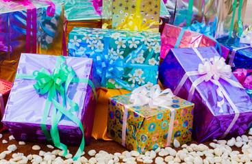 colorful gift box on the ground with white pebbles