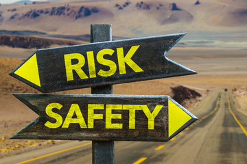 Risk - Safety signpost in a desert background