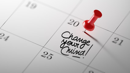 Concept image of a Calendar with a red push pin. Closeup shot of