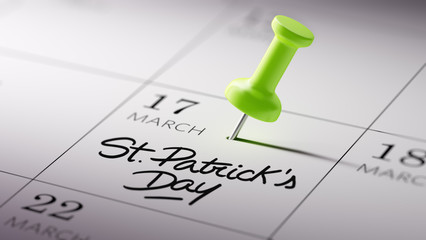 Concept image of a Calendar with a green push pin. Closeup shot