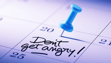 Concept image of a Calendar with a blue push pin. Closeup shot o