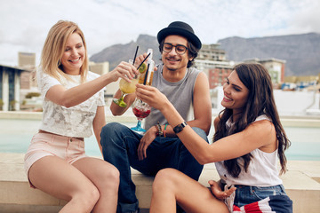 Happy young friends having cocktail party