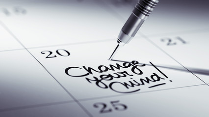 Concept image of a Calendar with a golden dart stick.. The words
