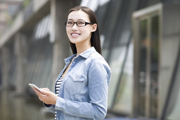 Young woman holding a smart phone