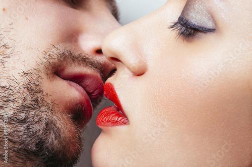 woman and woman kiss