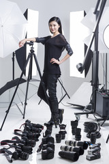 Photographer in studio with many cameras on the ground
