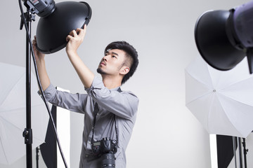 Photographer adjusting radar dome in studio