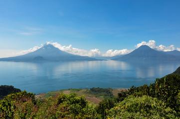 Lago Atitlan along with 2 volcanoes, Panajachel, Guatemala