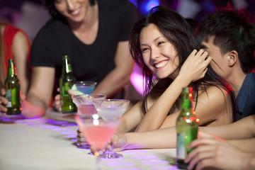 Stylish young people at bar counter