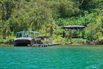 Tropical shore house and boat at dock Panama