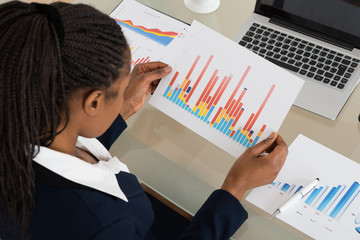 Businesswoman Analyzing Colorful Bar Graph