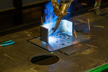 CNC robotic mig welding of half inch steel parts