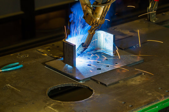 CNC robotic mig welding of half inch steel parts